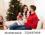 happy young couple drinking tea ... | Shutterstock . vector #722437459