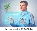 Young man with a virtual keyboard is studying the issue of ecology - stock photo