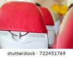 Small photo of airplane seat with belt while seated and life jacket under your seat text