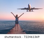 airplane and woman at sunset.... | Shutterstock . vector #722461369