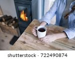 woman with cup of coffee... | Shutterstock . vector #722490874
