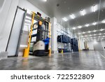 worker stand on stacker truck... | Shutterstock . vector #722522809