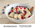 oatmeal with fresh berries and... | Shutterstock . vector #722531539