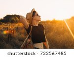 young woman hiking   Shutterstock . vector #722567485