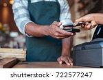 closeup of a customer using her ... | Shutterstock . vector #722577247