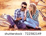 smiling young couple making...   Shutterstock . vector #722582149