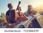 group of happy people in a car... | Shutterstock . vector #722586559