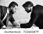 Small photo of victory and reward, defeat and loss, opposition of businessmen or men in suit, arm wrestling and power, business situation