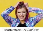 a young girl with purple hair...   Shutterstock . vector #722634649