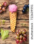 Small photo of Summer grape ice cream in a waffle cup cone