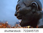 Small photo of Vancouver, British Columbia, Canada, 2012. A detail of the bronze sculpture A-maze-ing Laughter by Yue Minjun in morton park in English bay area