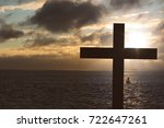 cross at the sea with rising sun | Shutterstock . vector #722647261