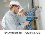 craftsman watching over his... | Shutterstock . vector #722695729