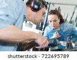 working in loud environment | Shutterstock . vector #722695789