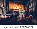 feet in woollen socks by the... | Shutterstock . vector #722746627
