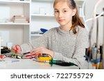 schoolgirl  repairing the...   Shutterstock . vector #722755729