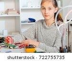 schoolgirl  repairing the...   Shutterstock . vector #722755735