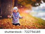 adorable happy girl throwing... | Shutterstock . vector #722756185
