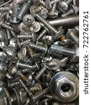 Small photo of bolts and nuts used in construction, bolts and nuts made of fine steel, bolt background, steel bolt, vertical background