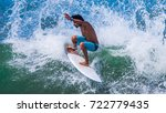 riding the waves. jeison torres ... | Shutterstock . vector #722779435
