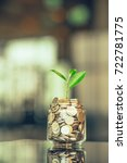plant growing out of coins with ...   Shutterstock . vector #722781775