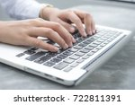 close up hands of an employee... | Shutterstock . vector #722811391