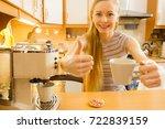 woman in kitchen making hot... | Shutterstock . vector #722839159