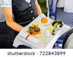 air hostess serves  | Shutterstock . vector #722843899