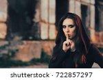 halloween woman keeping a... | Shutterstock . vector #722857297