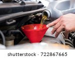 mechanic pouring oil to vehicle ...   Shutterstock . vector #722867665