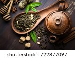 dried tea leaves with tea pot | Shutterstock . vector #722877097