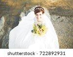 gorgeous beautiful bride smiles ... | Shutterstock . vector #722892931