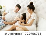 mother  father and a daughter... | Shutterstock . vector #722906785