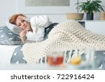 ill woman lying in bed looking... | Shutterstock . vector #722916424