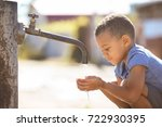 african american child drinking ... | Shutterstock . vector #722930395