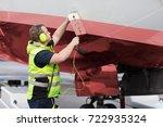 ground staff member adjusting... | Shutterstock . vector #722935324