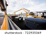 baggage on conveyor belt being... | Shutterstock . vector #722935369