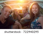 group of happy people in a car... | Shutterstock . vector #722940295