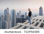 woman stands on roof of... | Shutterstock . vector #722956585