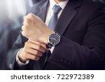 closeup watch on hand... | Shutterstock . vector #722972389