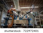 closeup robot welding arm in... | Shutterstock . vector #722972401