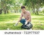 asian man picking up plastic... | Shutterstock . vector #722977537