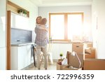 portrait of young couple moving ... | Shutterstock . vector #722996359