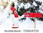 happy child in knitted reindeer ...   Shutterstock . vector #723014725