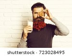 handsome bearded man with... | Shutterstock . vector #723028495