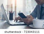 businessman in blue shirt and... | Shutterstock . vector #723043111