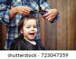 a little boy is trimmed in the... | Shutterstock . vector #723047359