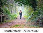 Young Woman Walking Crossing A...
