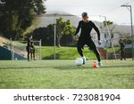 young soccer player training in ... | Shutterstock . vector #723081904