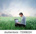 businessman on a green meadow... | Shutterstock . vector #72308224